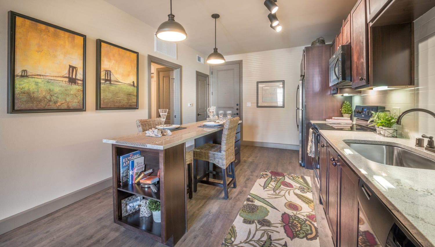 Well-decorated open-concept model home at Union At Carrollton Square in Carrollton, Texas
