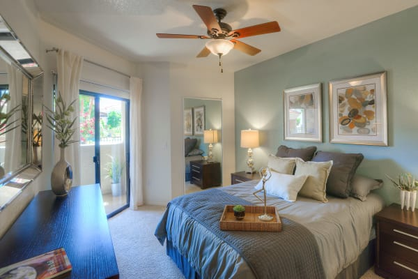 Spacious bedroom with a ceiling fan at San Prado in Glendale, Arizona