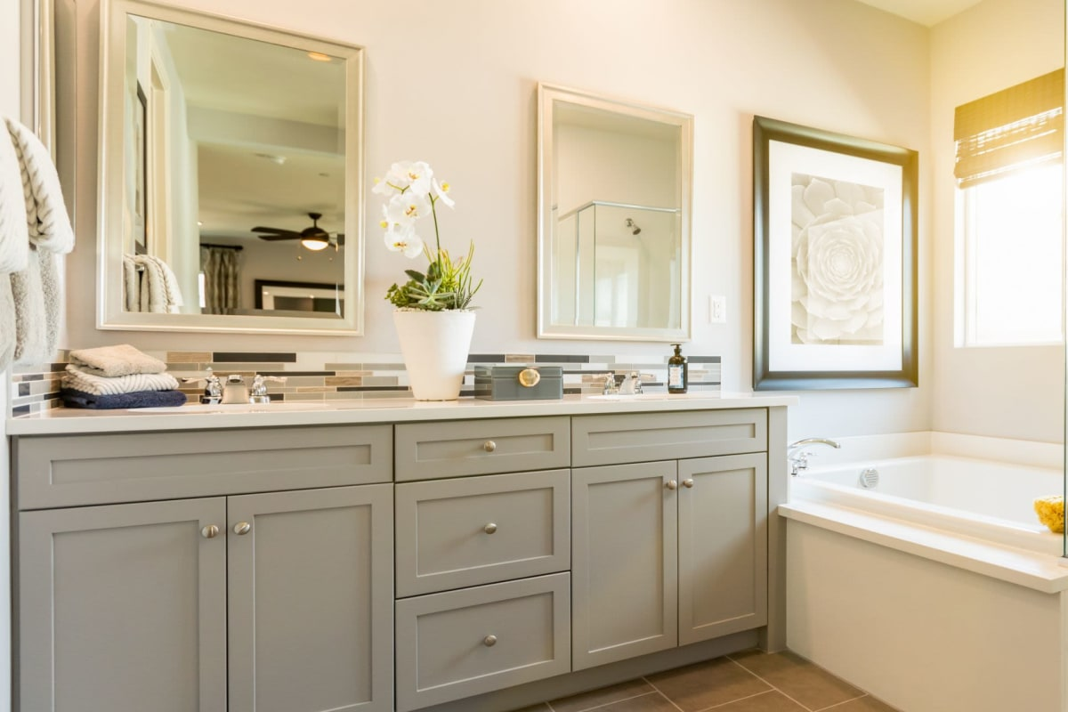 Bathroom with tiled flooring and a granite countertop in a model apartment home at The Pointe at Siena Ridge in Davenport, Florida
