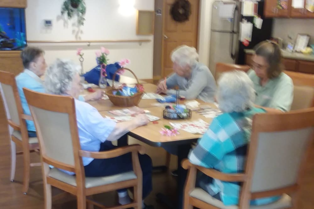 Residents gather for a craft project at Arlington Place of Red Oak in Red Oak, Iowa