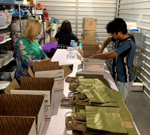 people packaging supplies and resources