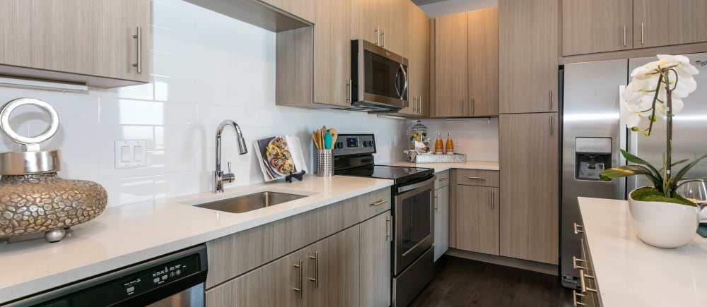 Beautiful, tan kitchen cabinetry at Strata Apartments in Denver, Colorado