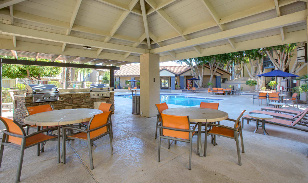Outdoor sitting area by pool at apartments in Tempe, Arizona