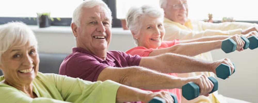 Residents engaged in a group exercise at The Springs at Lancaster Village in Salem, Oregon