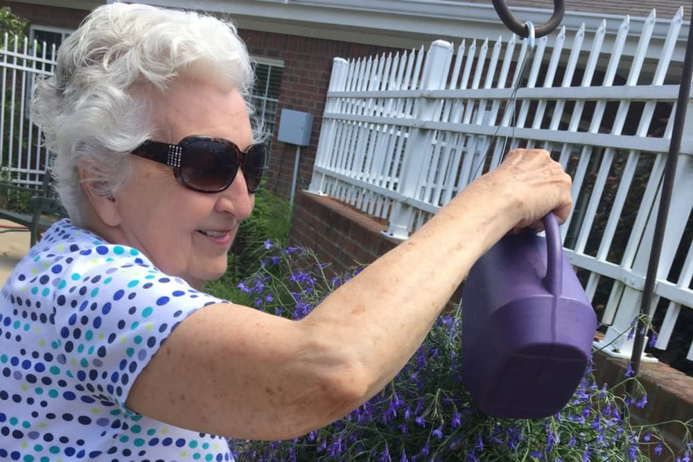A resident watering plans at Morrison Woods Health Campus in Muncie, Indiana