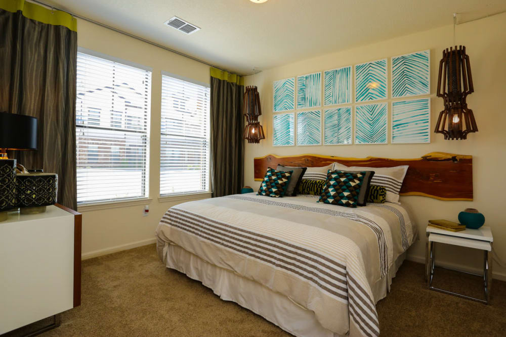 Large bay windows in a model home's bedroom at The Hawthorne in Jacksonville, Florida
