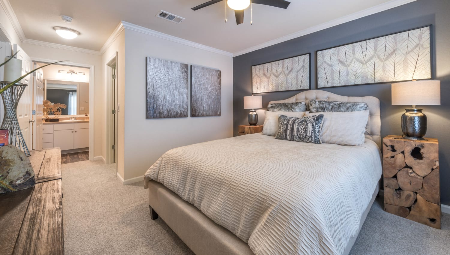 Spacious master bedroom with an en suite bathroom in a model home at Olympus Hillwood in Murfreesboro, Tennessee