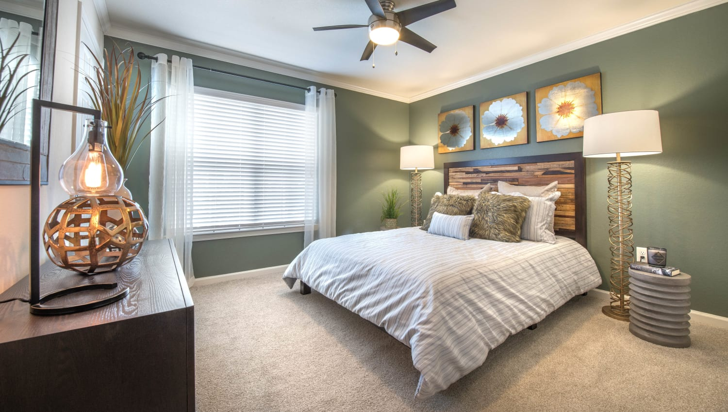 Bay windows and plush carpeting in a model home's master bedroom at Olympus Hillwood in Murfreesboro, Tennessee