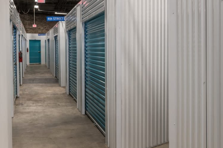 Well lit hallway of storage units at Riverfront Self Storage in New Orleans, Louisiana