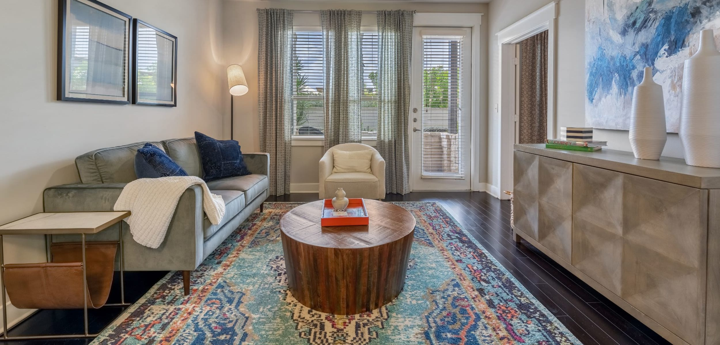 Living room with wood style floors at Marquis Cresta Bella in San Antonio, Texas