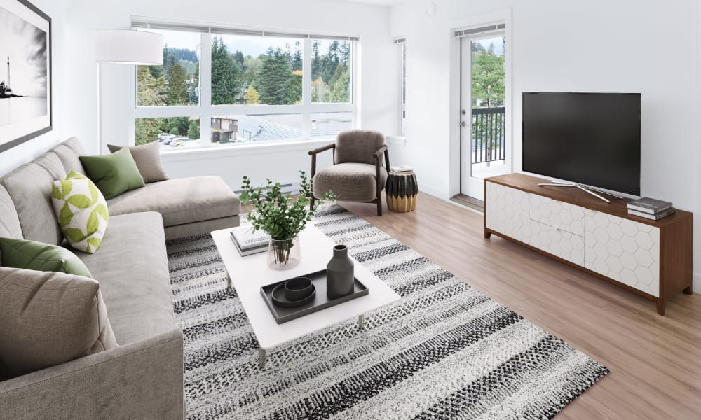 Large windows in model living room at Northwoods Village in North Vancouver, British Columbia