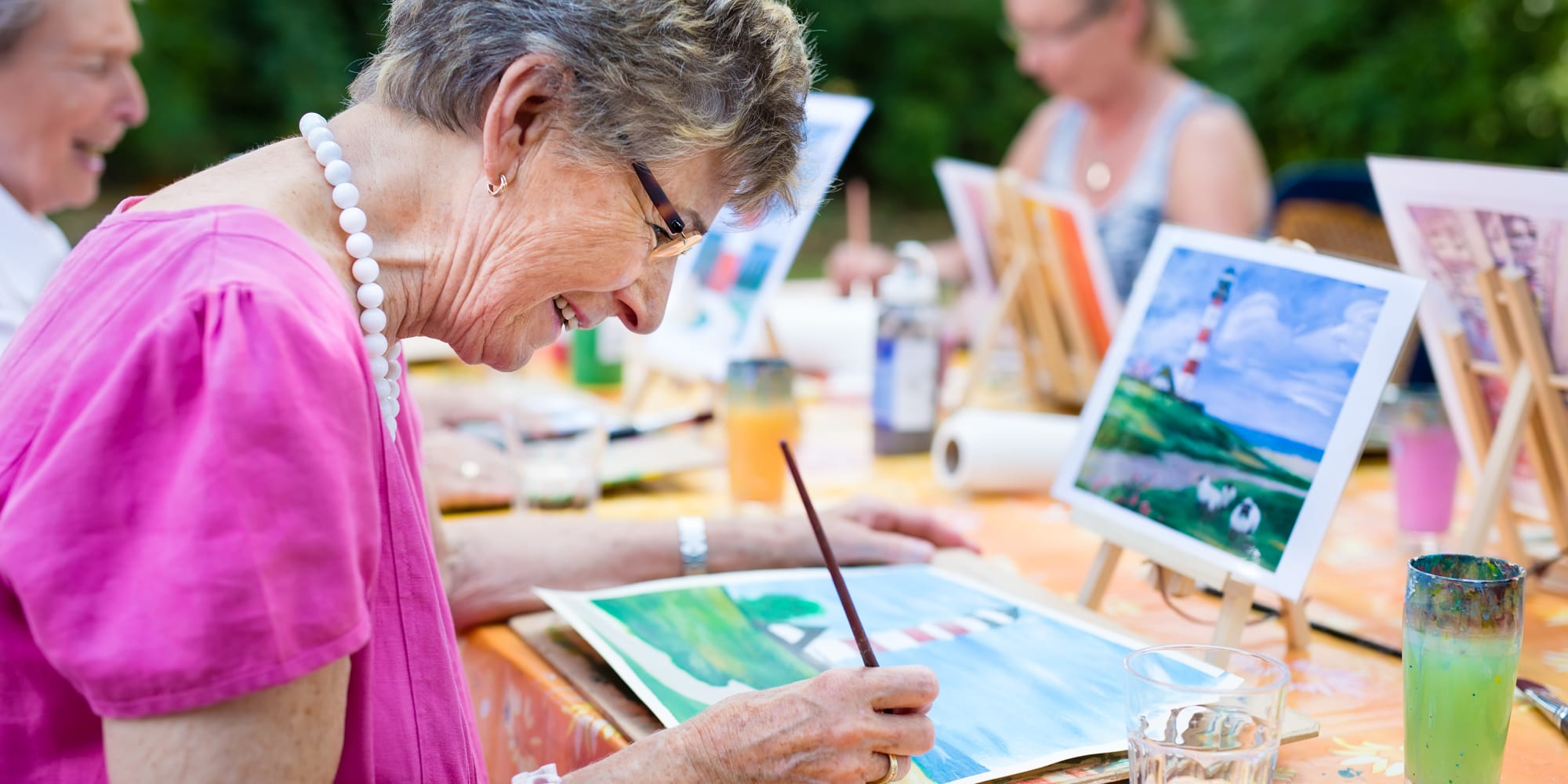 Resident working on a painting at Prestonwood Court in Plano, Texas