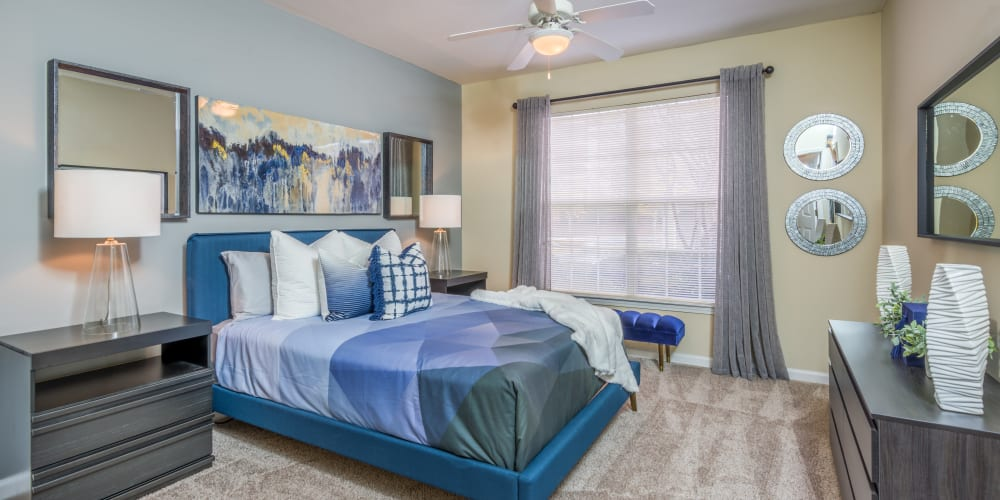 Bedroom with ceiling fan at One Rocky Ridge Apartment Homes in Douglasville, Georgia