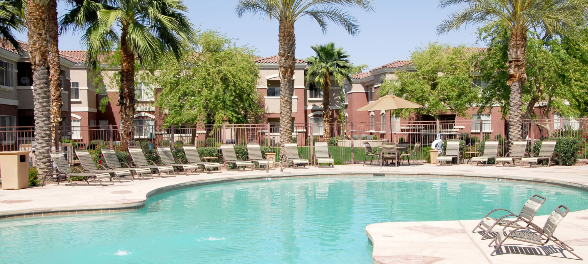 Swimming pool with lounge chairs at Remington Ranch in Litchfield Park, Arizona
