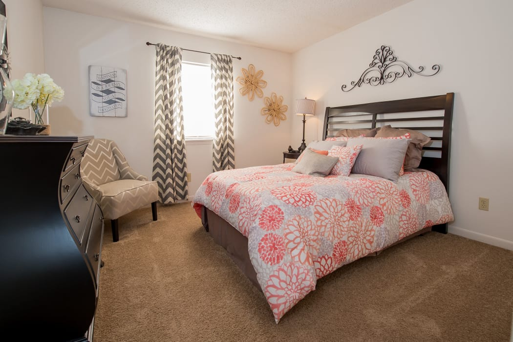 Beautiful bedroom at The Mark Apartments in Ridgeland, Mississippi