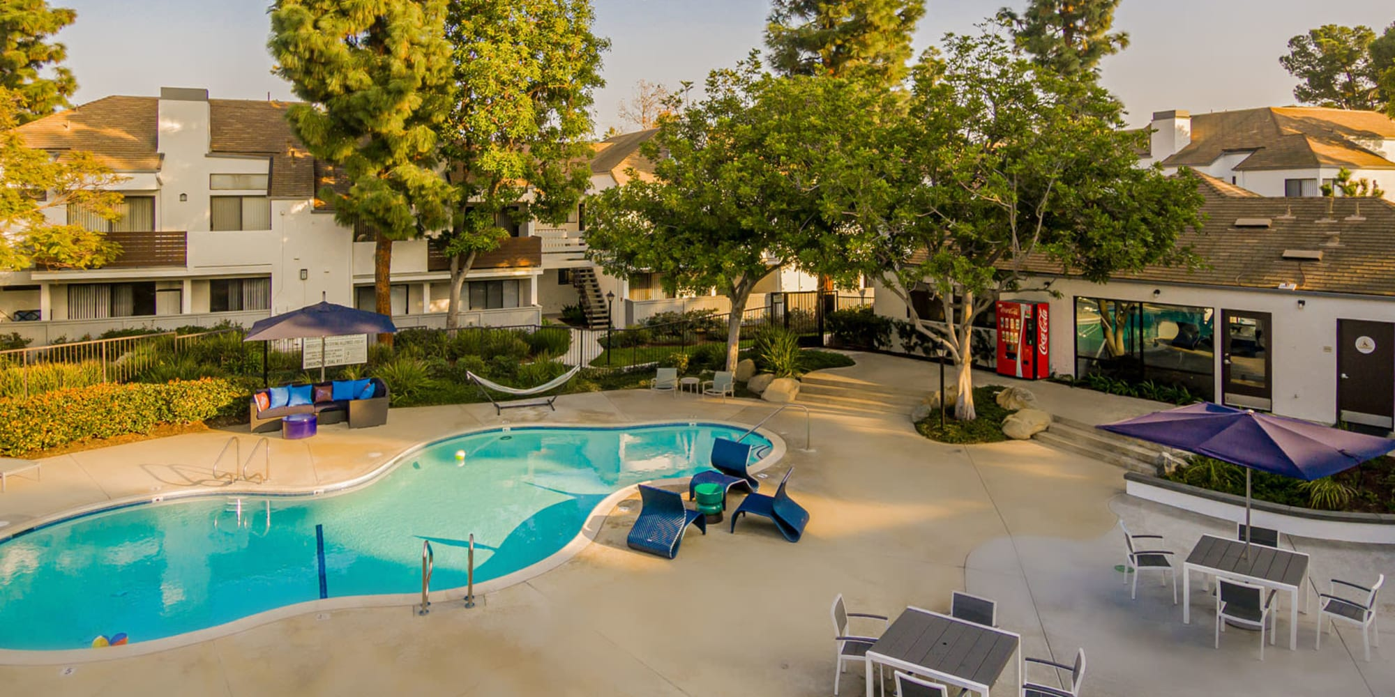 Great places to sit and visit with your neighbors near the swimming pool at Sendero Huntington Beach in Huntington Beach, California