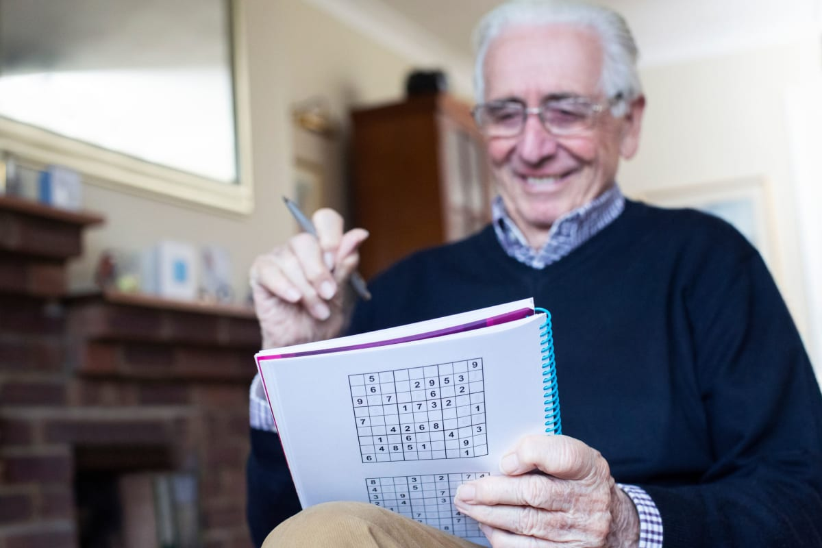 A resident doing a word search at Ashbrook Village in Duncan, Oklahoma