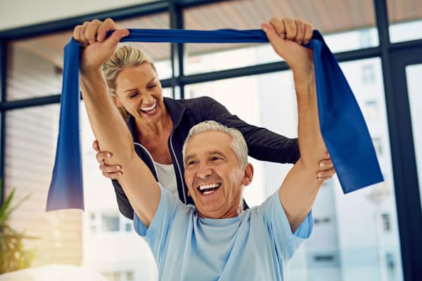 Resident working with a physical trainer at Deephaven Woods in Deephaven, Minnesota