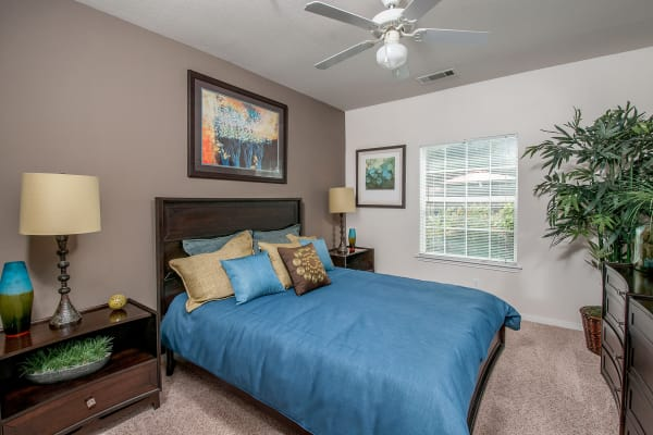 Naturally well-lit bedroom at Sunrise Canyon in Universal City, Texas