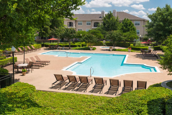 Outdoor pool at Ballantyne Apartments in Lewisville, Texas