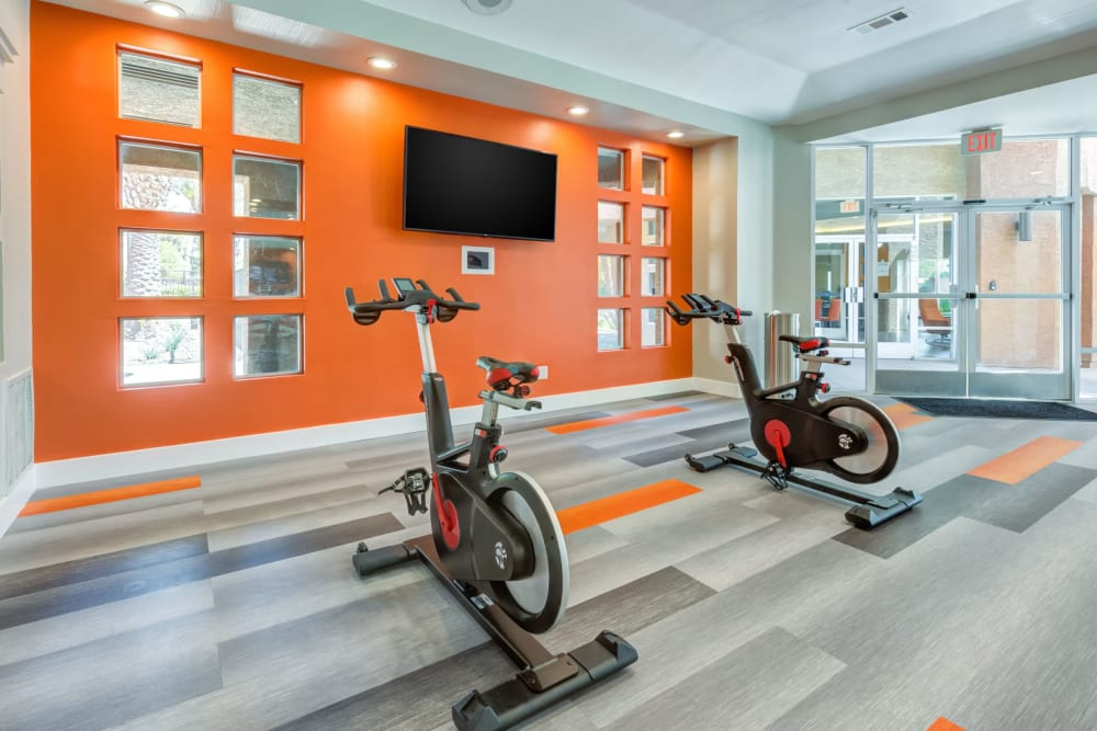Fitness center with plenty of individual workout stations at Tuscany Village Apartments in Ontario, California