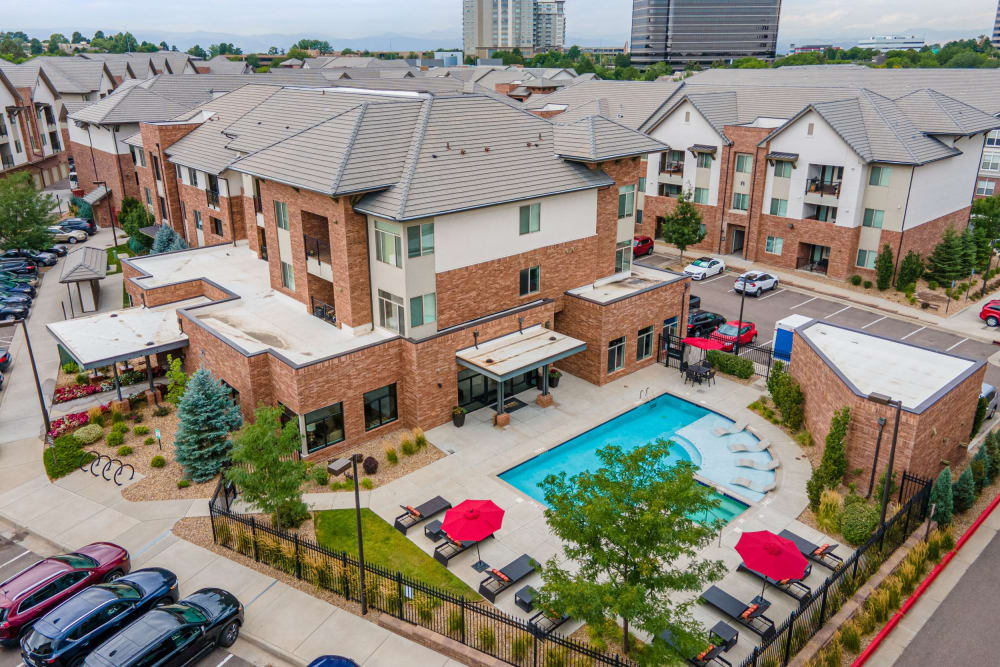 Aerial view of apartment buildings and outdoor community pool at The Parc at Greenwood Village in Greenwood Village, Colorado