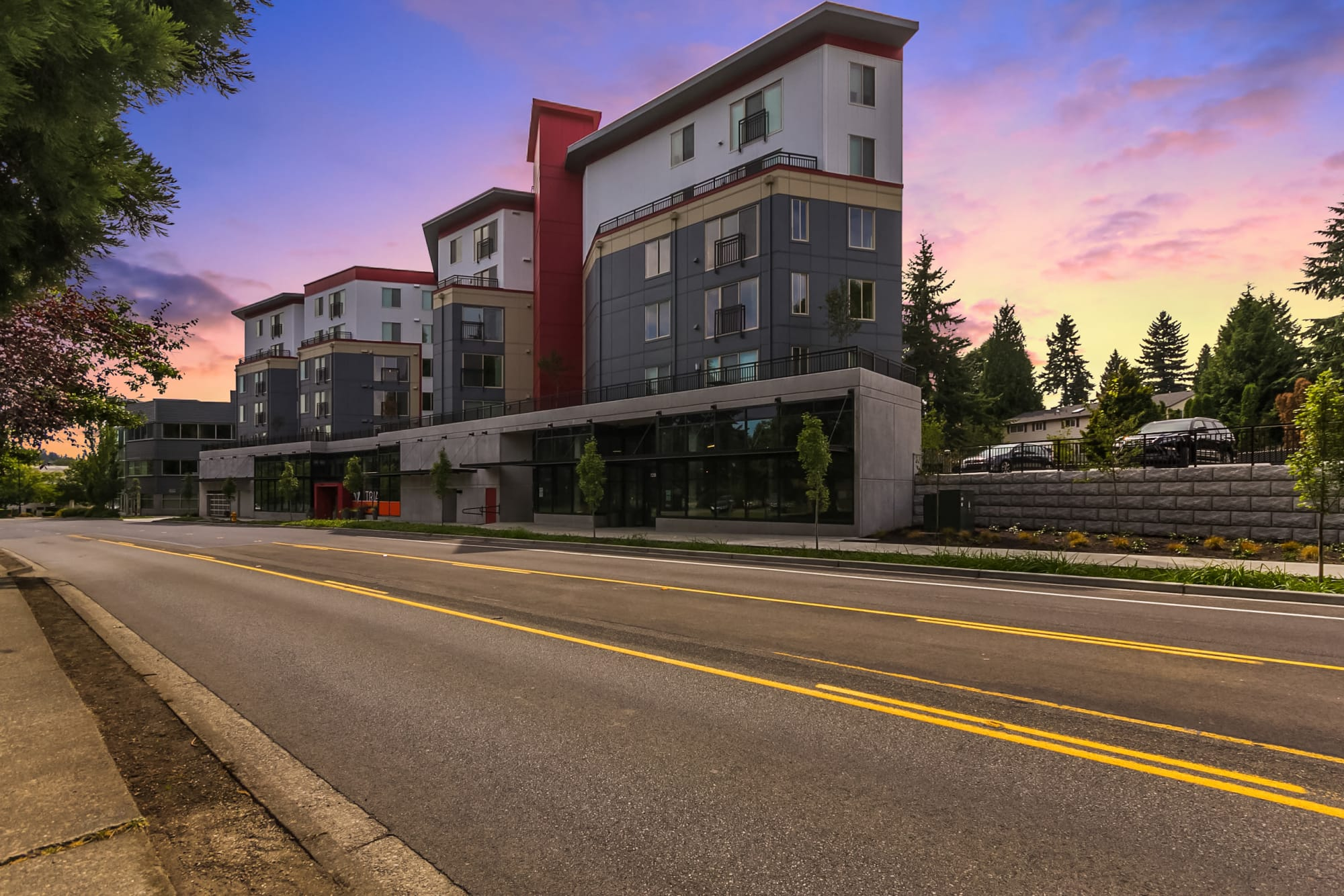 Exterior view of buildings at sunset of Tria Apartments in Newcastle