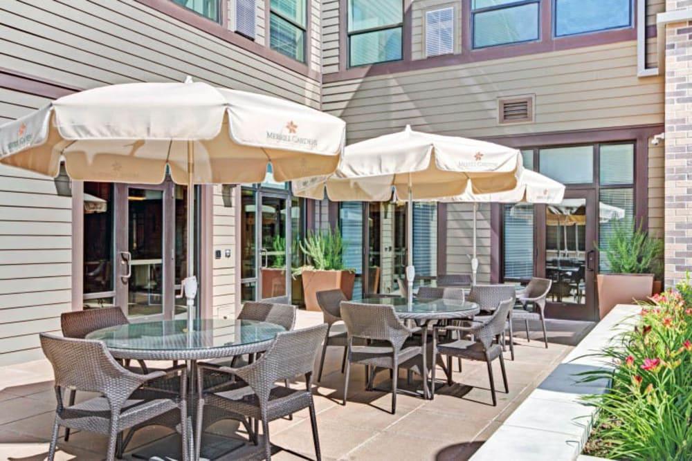 Patio with umbrellas at Merrill Gardens at Lafayette in Lafayette, California.