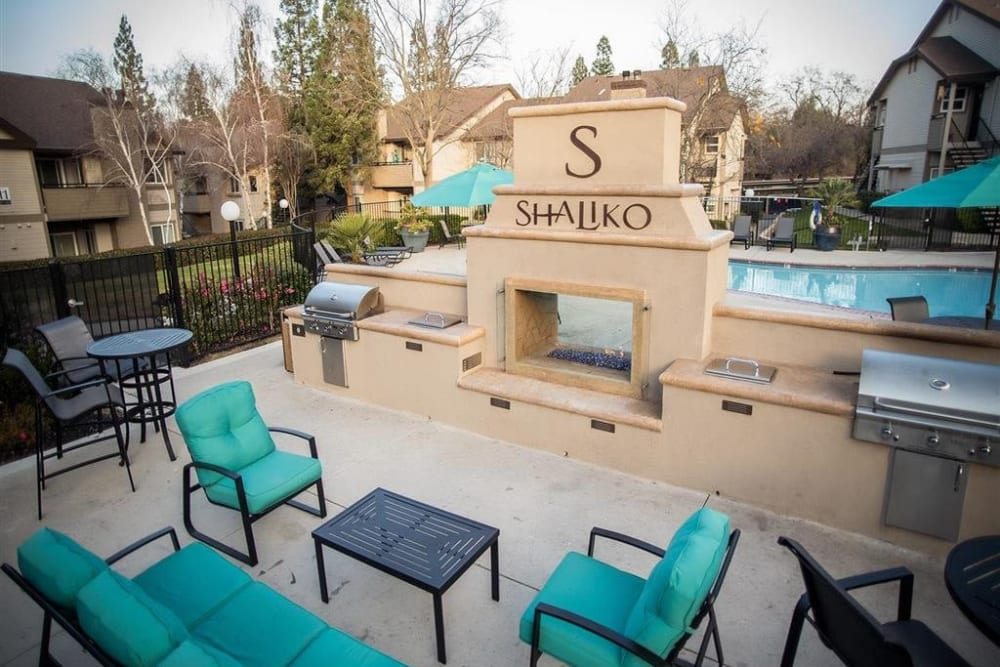 Outdoor fireplace with gas grills at Shaliko in Rocklin, California.