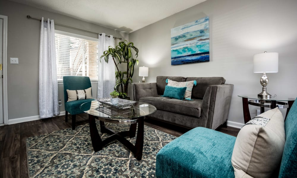 Living room with blue painting at Lexington Park Apartments in Smyrna, Georgia