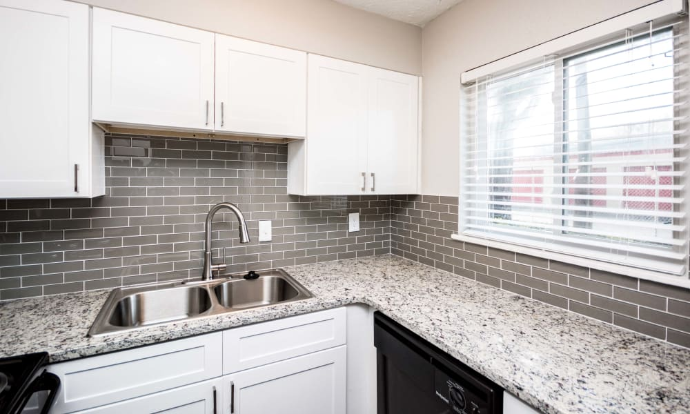 Bright kitchen with white cabinets at Lexington Park Apartments in Smyrna, Georgia