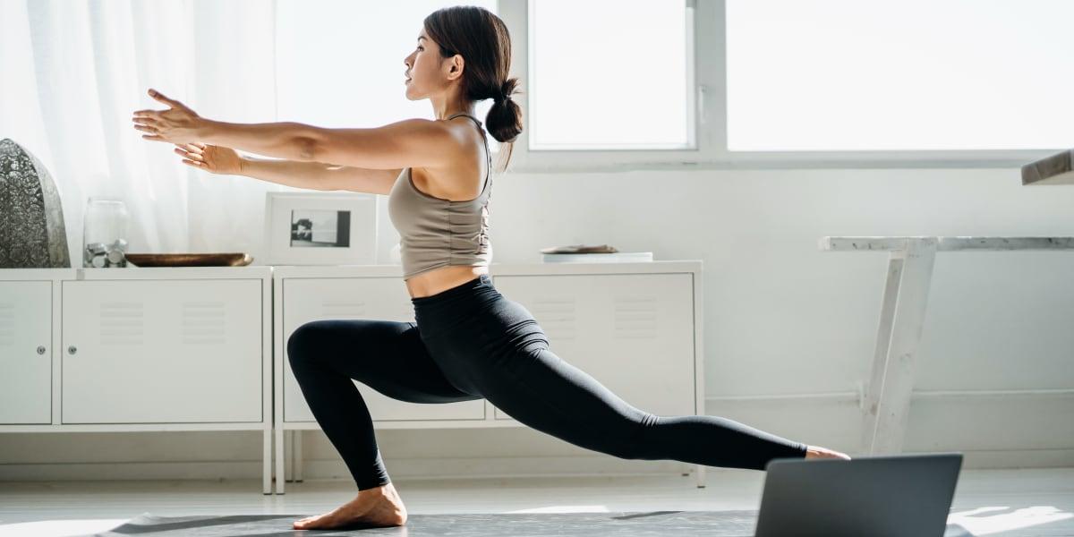 Resident doing yoga at Marquis at Silverton in Cary, North Carolina