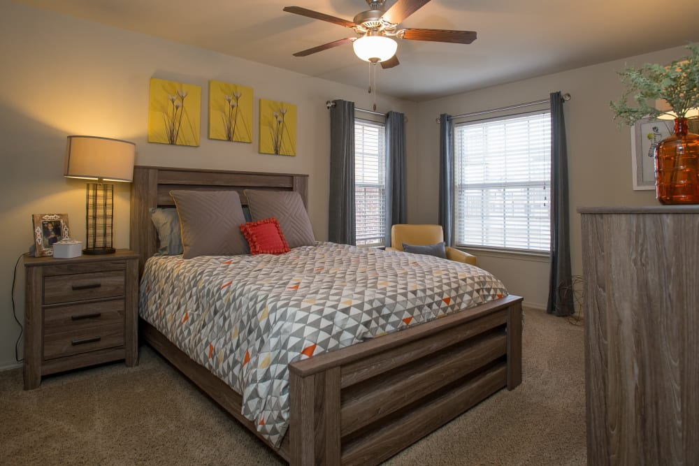Bedroom with a ceiling fan at Portofino Apartments in Wichita, Kansas