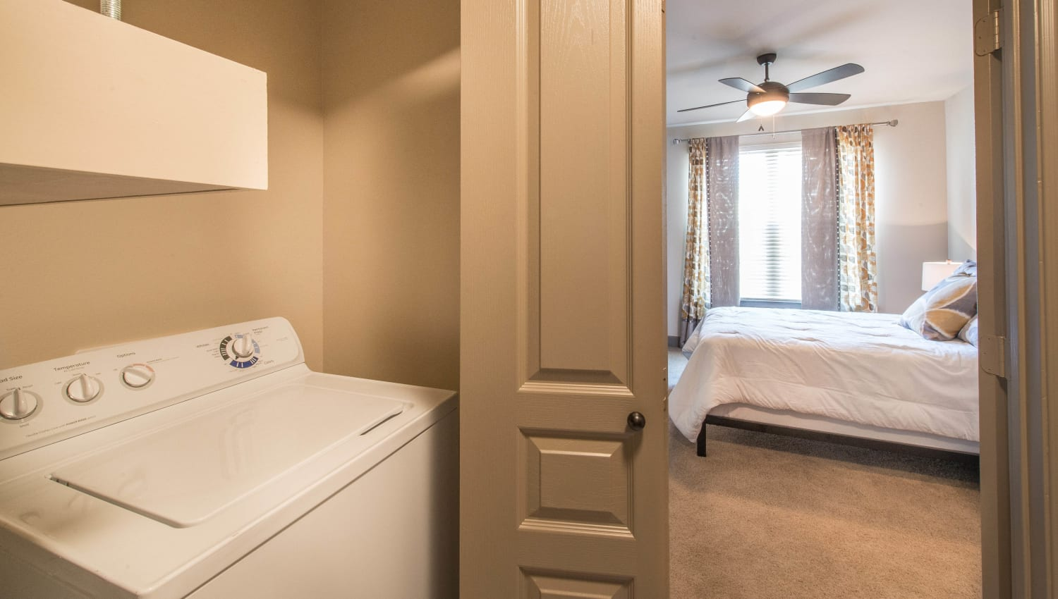 Full-size in-unit washer and dryer in a model home at Union At Carrollton Square in Carrollton, Texas