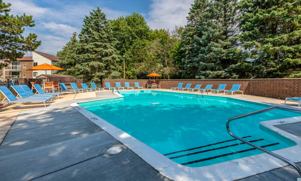 Swimming pool on a sunny day at Okemos Station Apartments in Okemos, Michigan