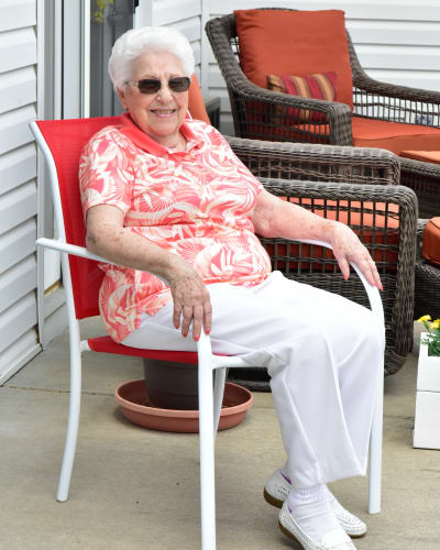 Resident relaxing in a chair outside at Garden Place Red Bud in Red Bud, Illinois.