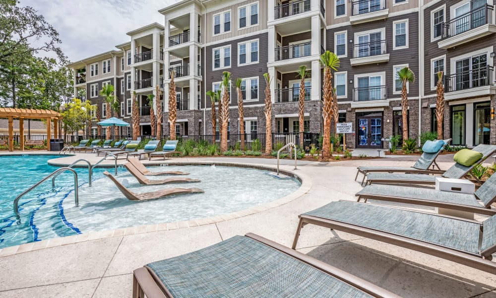 Pool with many tanning chairs at The Heyward in Charleston, South Carolina