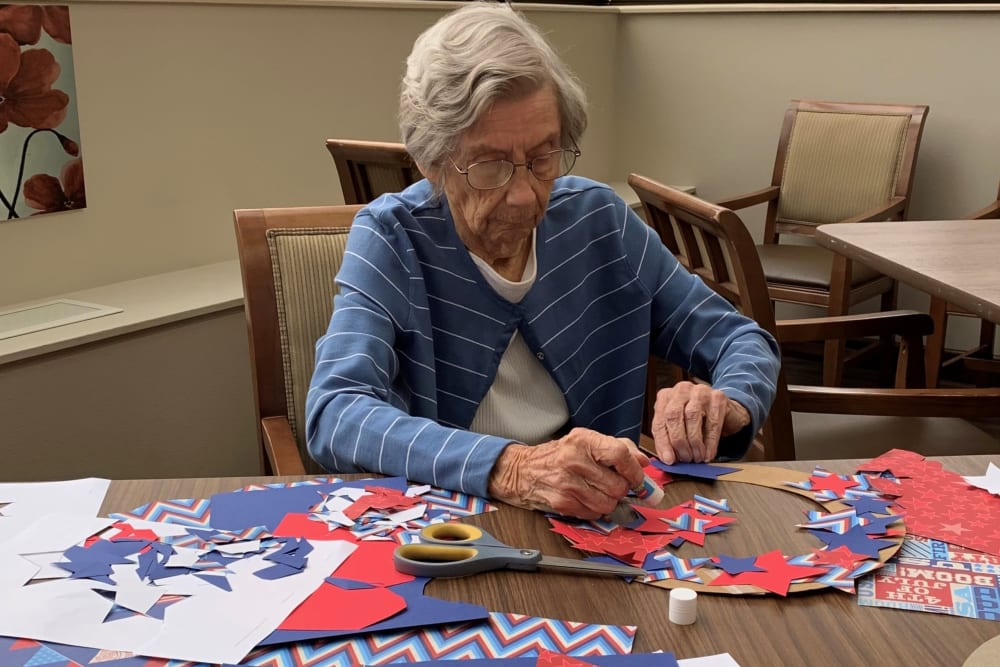 Resident making her own wreath at Brown Deer Place in Coralville, Iowa