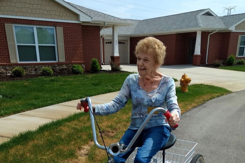 A resident riding a bike at Creasy Springs Health Campus in Lafayette, Indiana