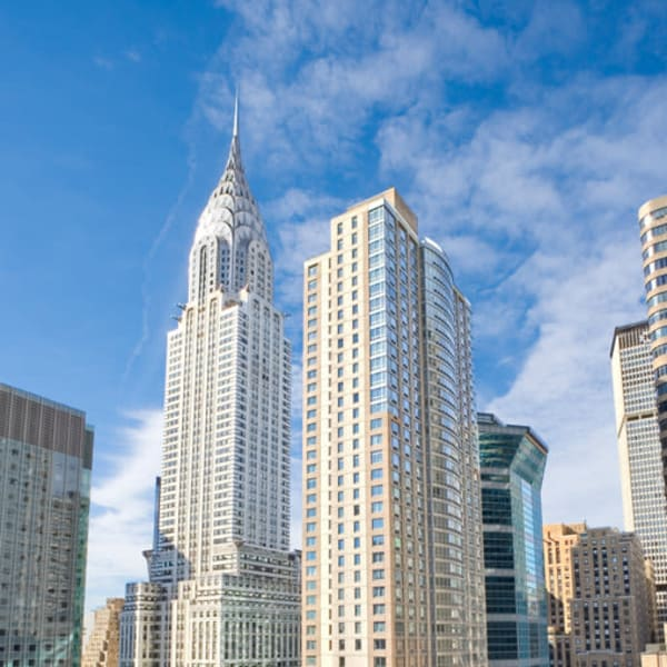 Exterior view of The Metropolis in New York, New York on a blue bird day