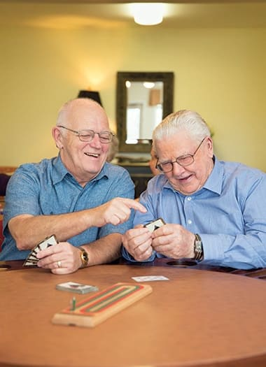 Seniors playing cribbage at Burr Ridge Senior Living in Burr Ridge, IL