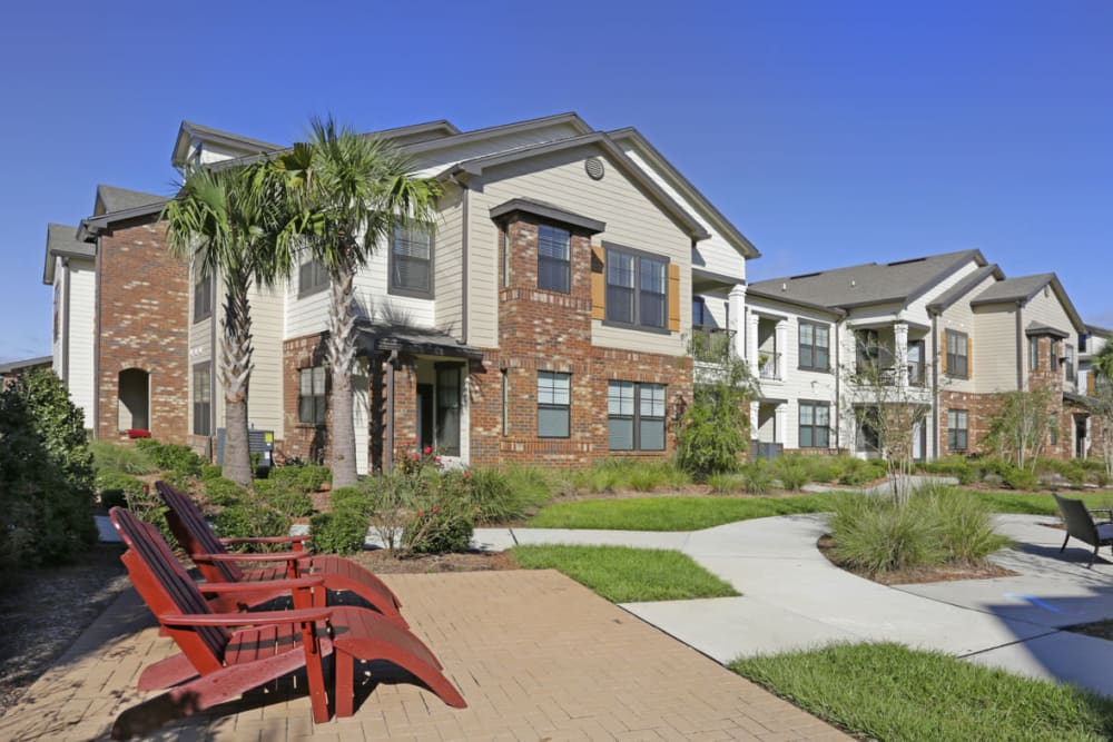 Well-maintained landscaping outside resident buildings at The Hawthorne in Jacksonville, Florida