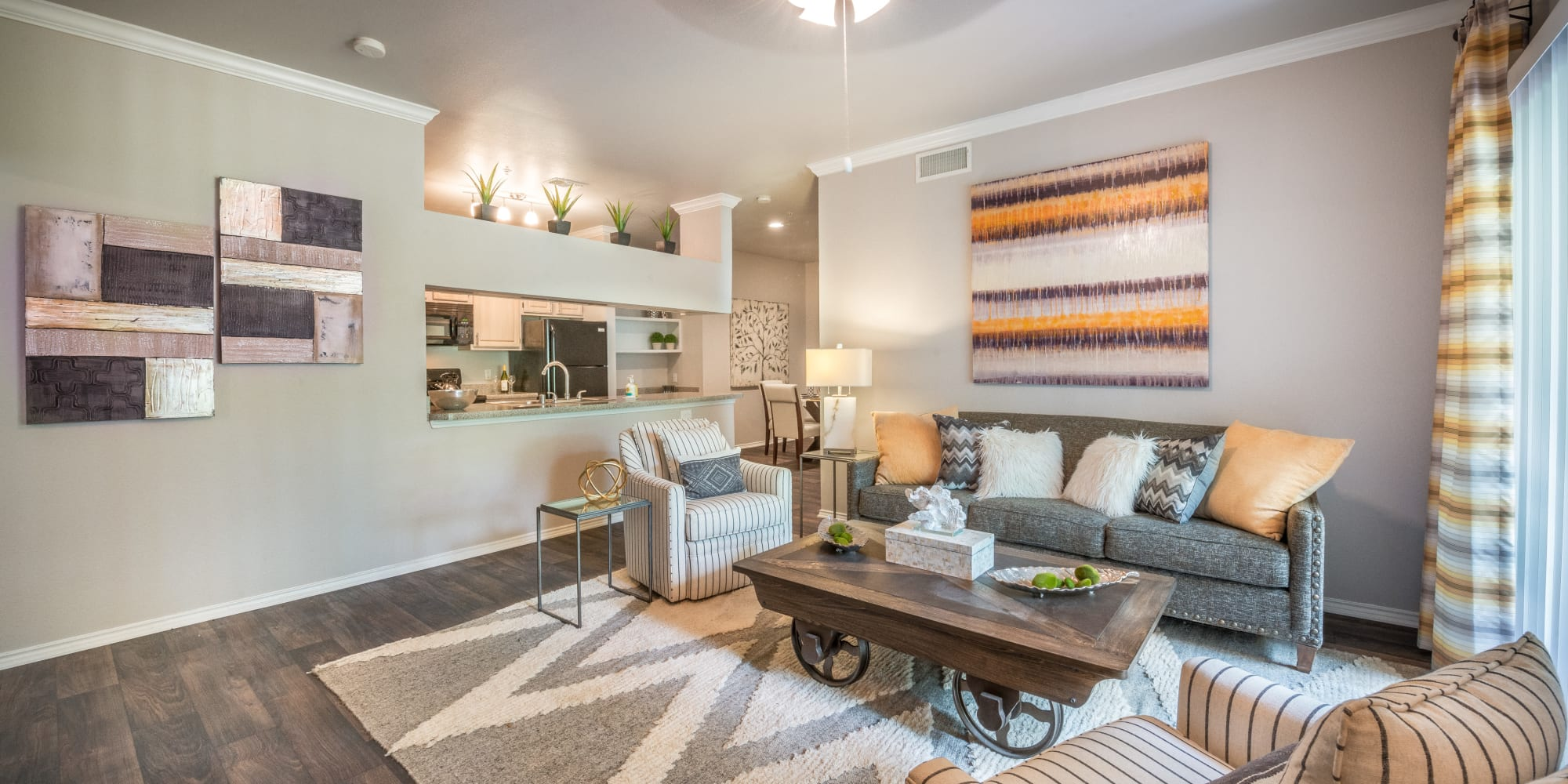 Well-furnished living area with hardwood floors in a model home at 23Hundred @ Ridgeview in Plano, Texas