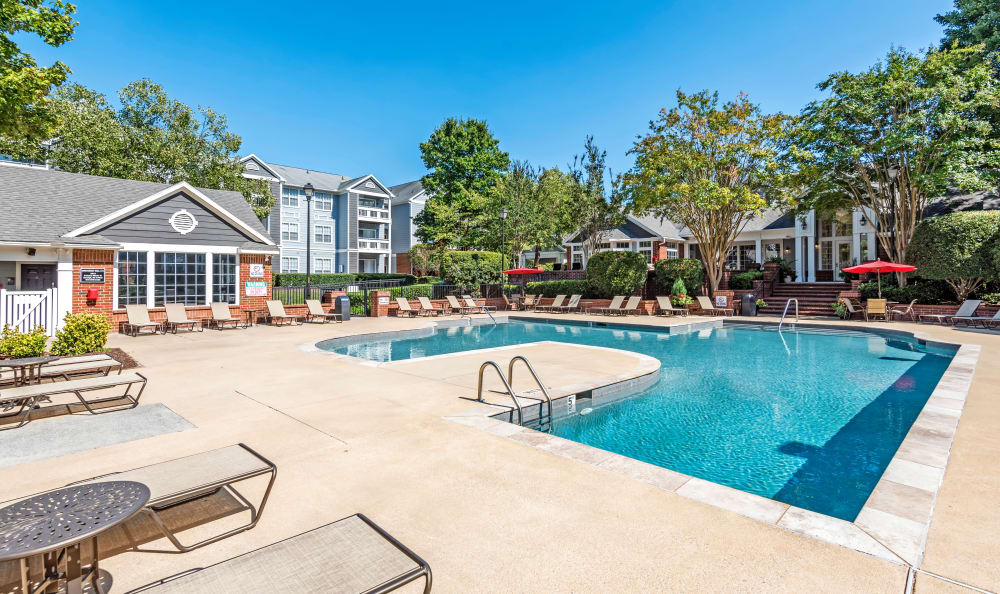 A sparkling pool is just one of the many amenities that The Village Apartments has to offer