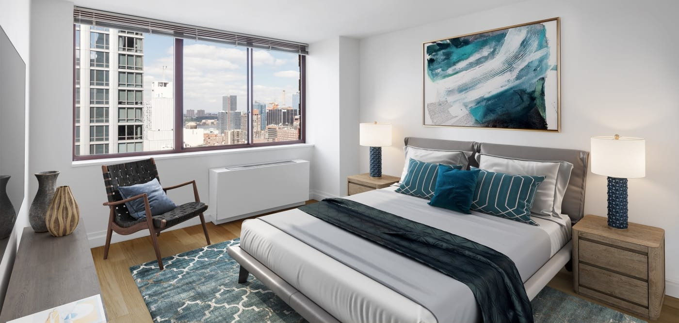 Master bedroom with a large window for natural lighting at The Ellington in New York, New York