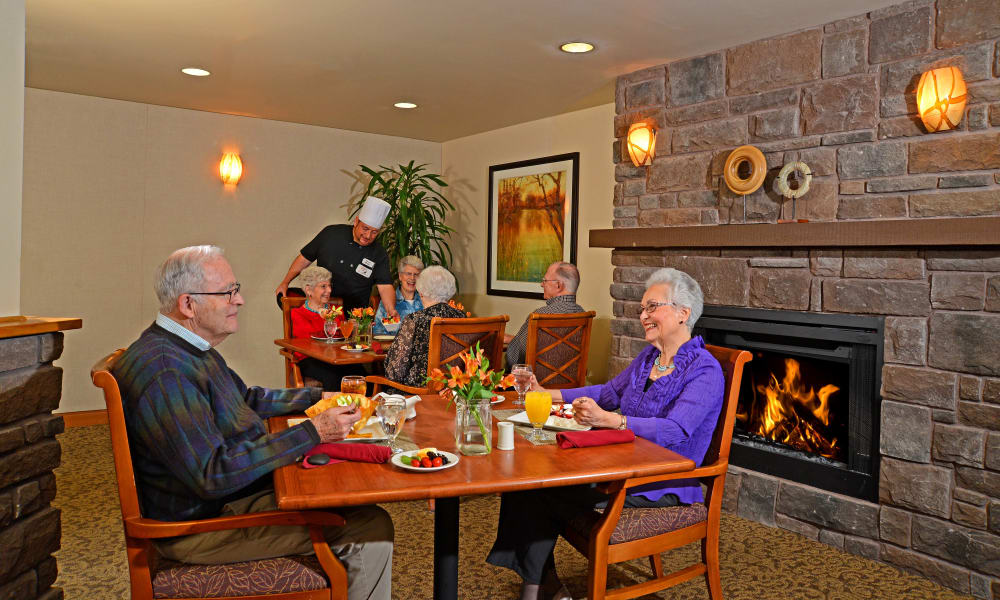 Seniors having breakfast in the dining room at Quail Park of Lynnwood in Lynnwood, Washington
