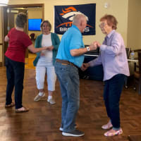 Happy seniors enjoying activities at Eastern Star Masonic Retirement Campus in Denver, CO