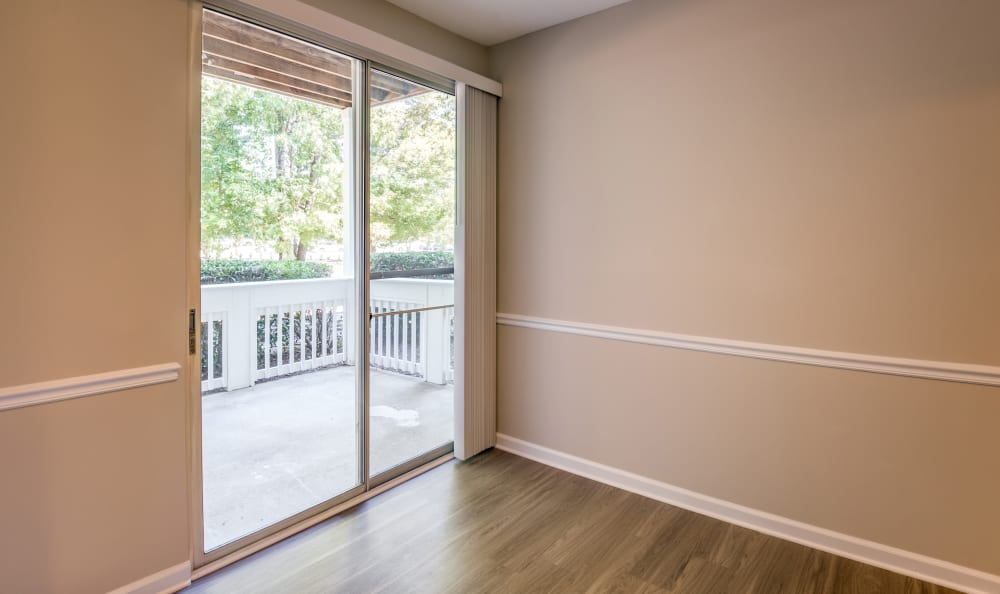 Sliding glass door leading to your beautiful desk at The Village Apartments