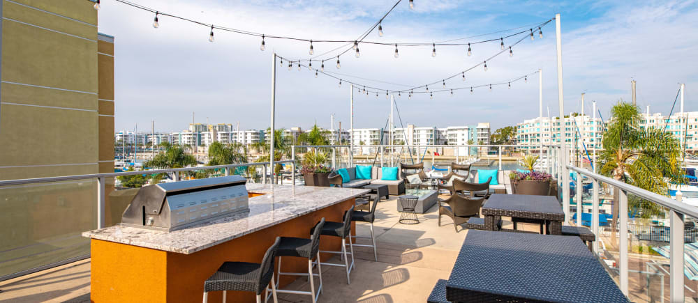 A barbecue and seating on the sundeck at Harborside Marina Bay Apartments in Marina del Rey, California