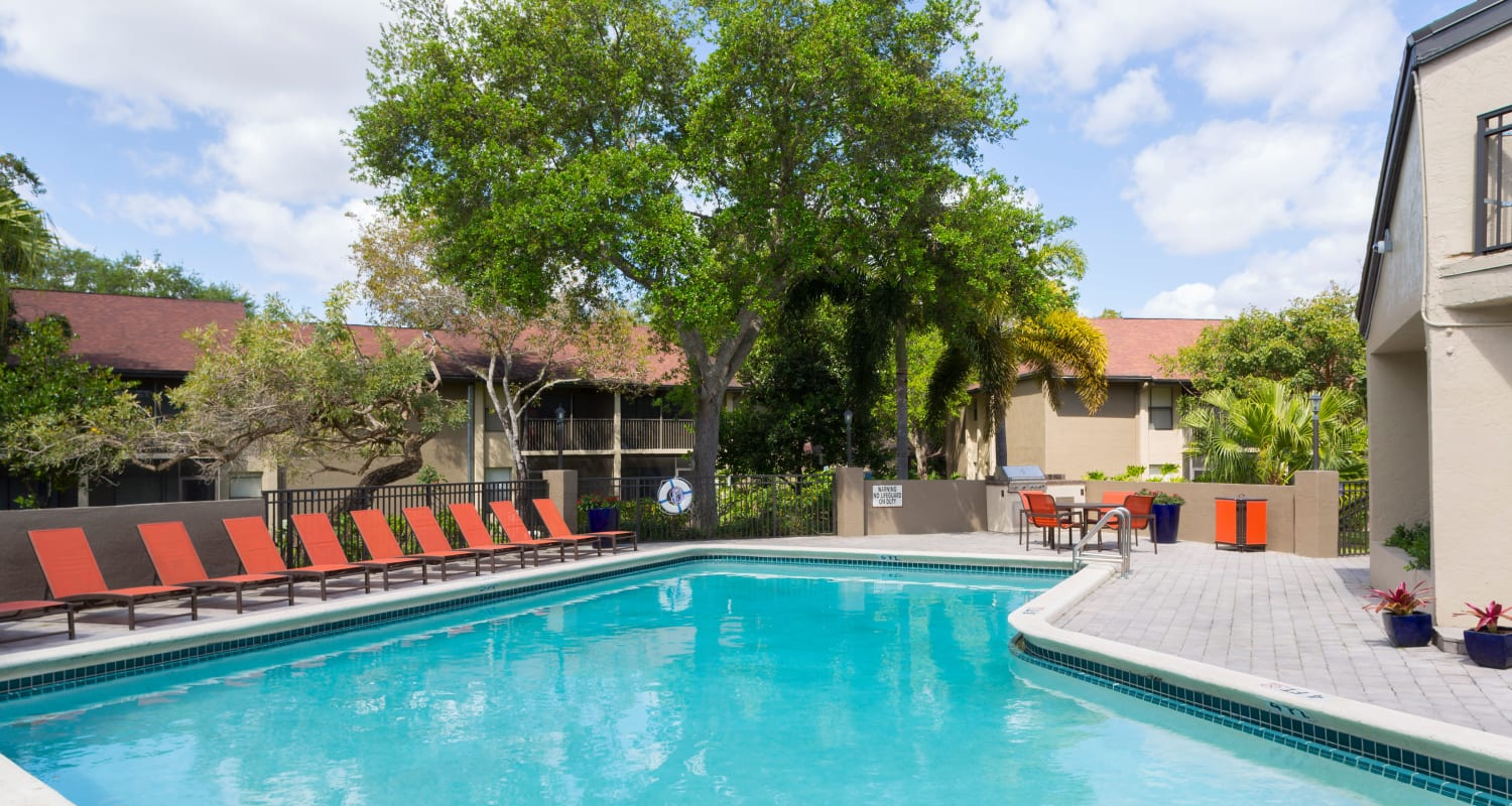 Pool deck with lounge chairs at Siena Apartments in Plantation, Florida